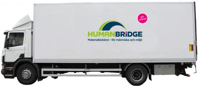 Lastbil med ny logga + tagline